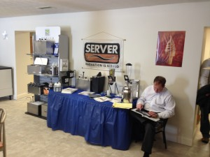 Server Products, Robert Sand/Byrne Reps, preparing a quote for a guest.