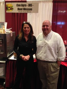 Lisa Gallagher w/Con Agra Foods Sean Reitz w/Rep Group, Acosta Food Service. Displaying their new birthday cake cone coating and other great tasting products